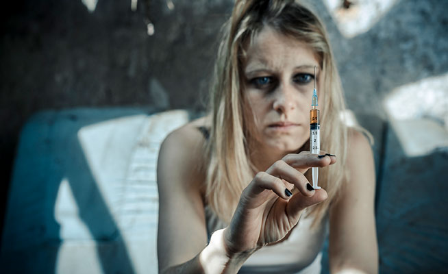 woman with heroin needle