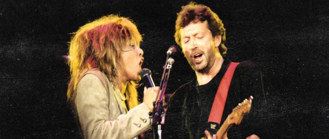 Tina Turner and Eric Clapton singing on stage at Wembley Arena in London in 1987