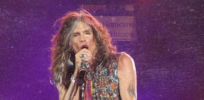 Steven Tyler singing into microphone on stage for band Aerosmith