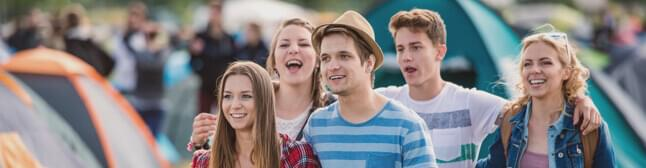Small group of young adults and a festival.