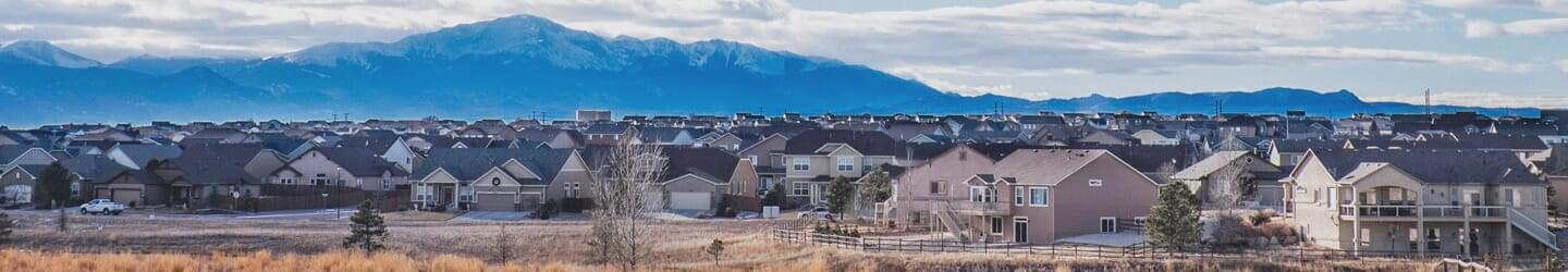 Colorado Springs residential area with mountain range backdrop