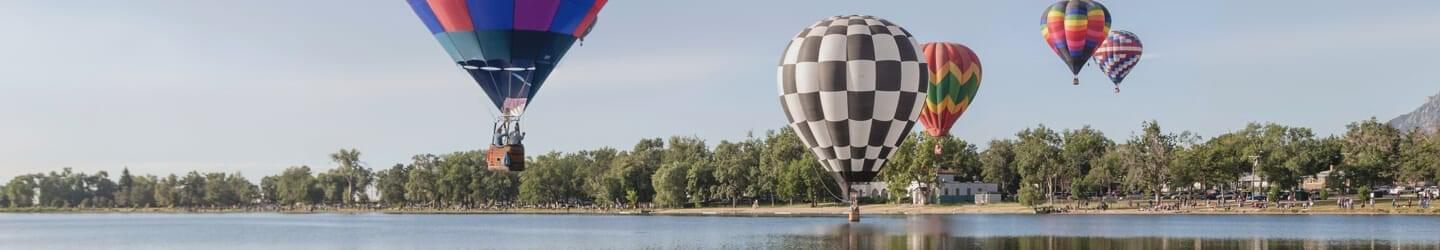 View of lake with hot air balloons