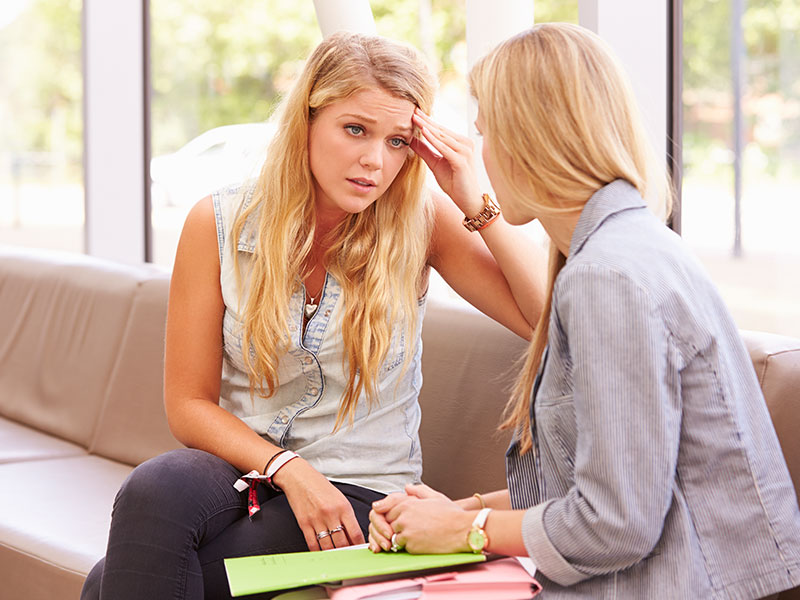Depressed student talking to Counselor