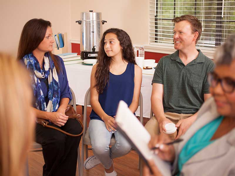 Multi-ethnic group of people in counseling session with therapist