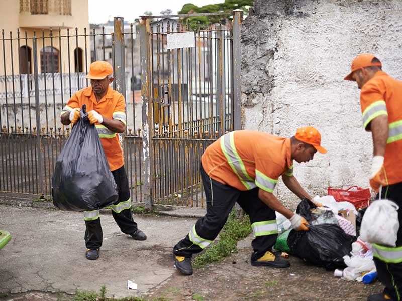 Waste Management wrokers collecting trash