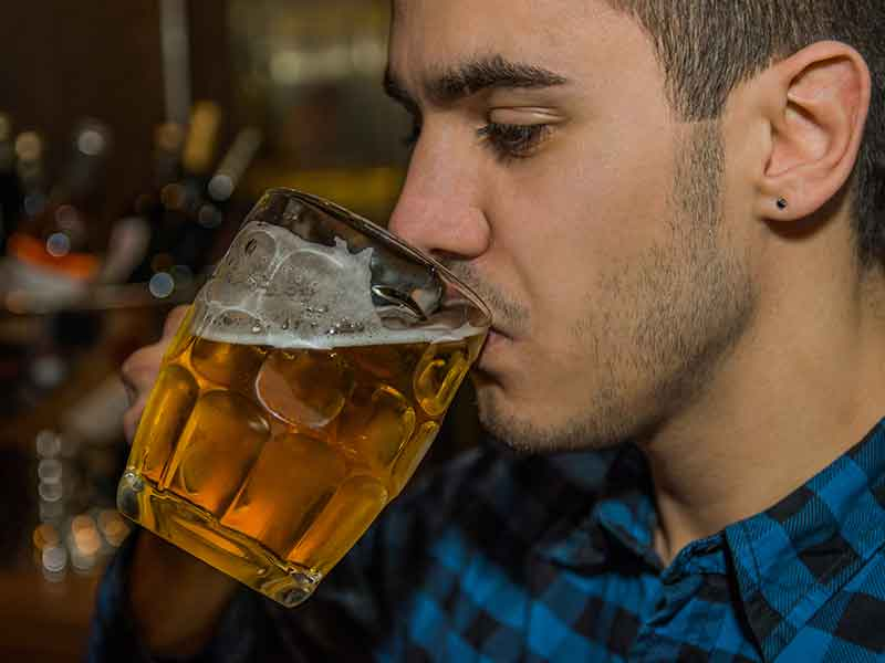 Young student drinking non-aocoholic beer