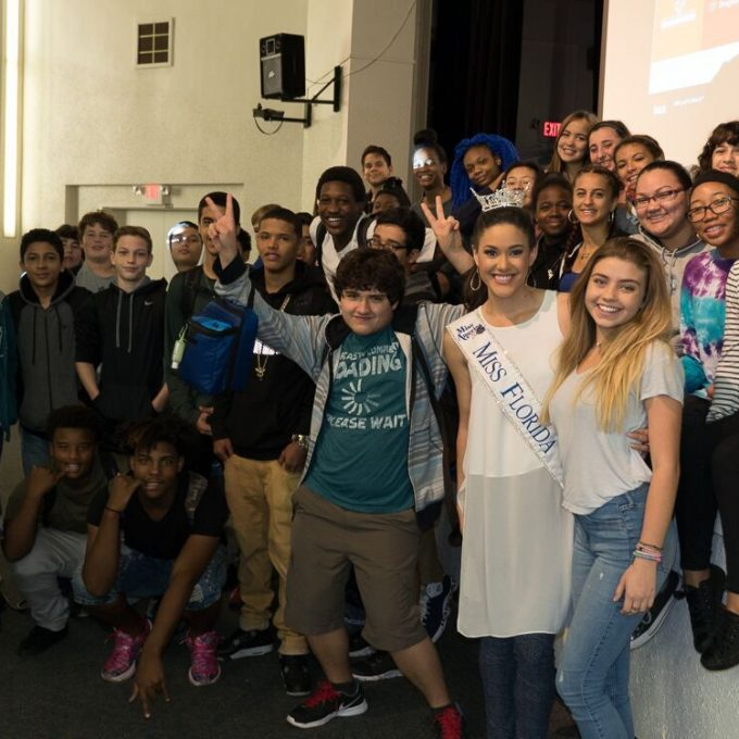Courtney Sexton with high school students after Real Talk