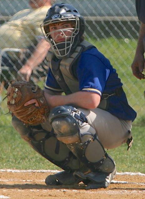 Jordan Strickland playing catcher in baseball